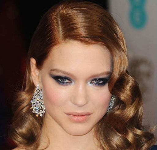 Lea Seydoux wearing a pair of diamond earrings set in Fairmined gold at the BAFTAs