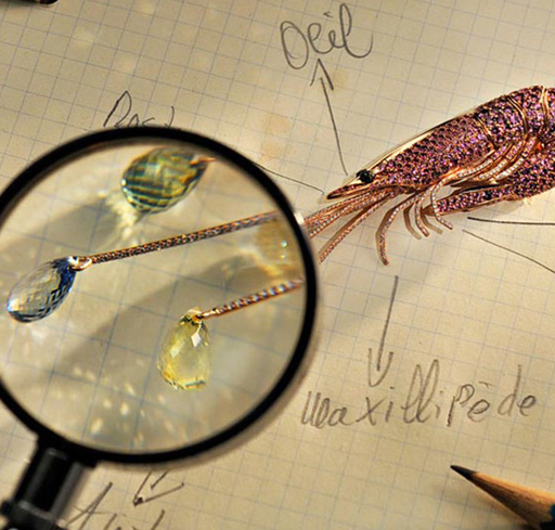 Each designed as a perfectly pink diamond shrimp from whose antennae dangle colourful sapphire briolettes.