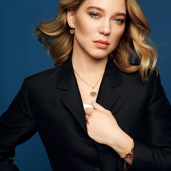 Close-up of Léa Seydoux wearing happy hearts necklace