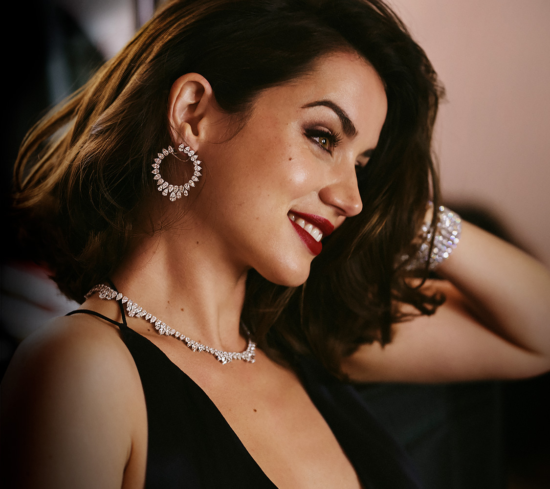 Close-up of Ana de Armas wearing a black dress with necklace, earrings and bracelet of Chopard