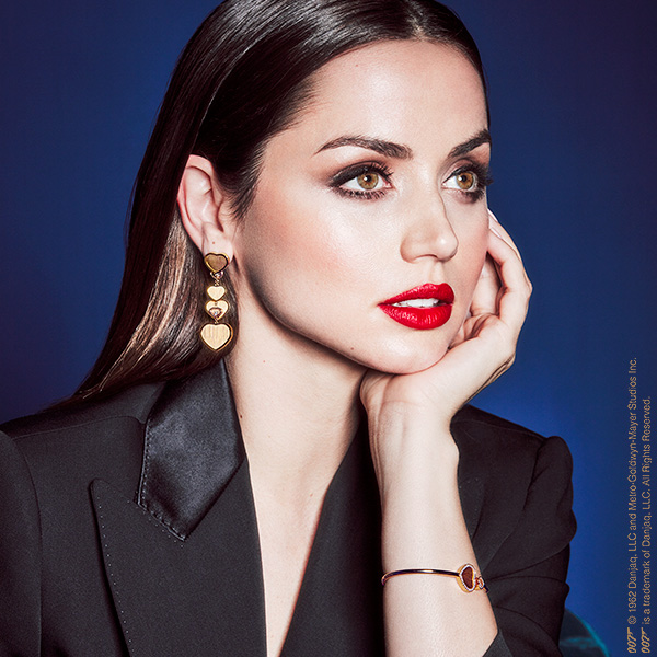 Close-up of Ana de Armas wearing earrings and bracelet of Chopard happy hearts collection