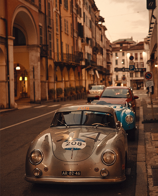 Classic car in a street in Italy at nightfall.