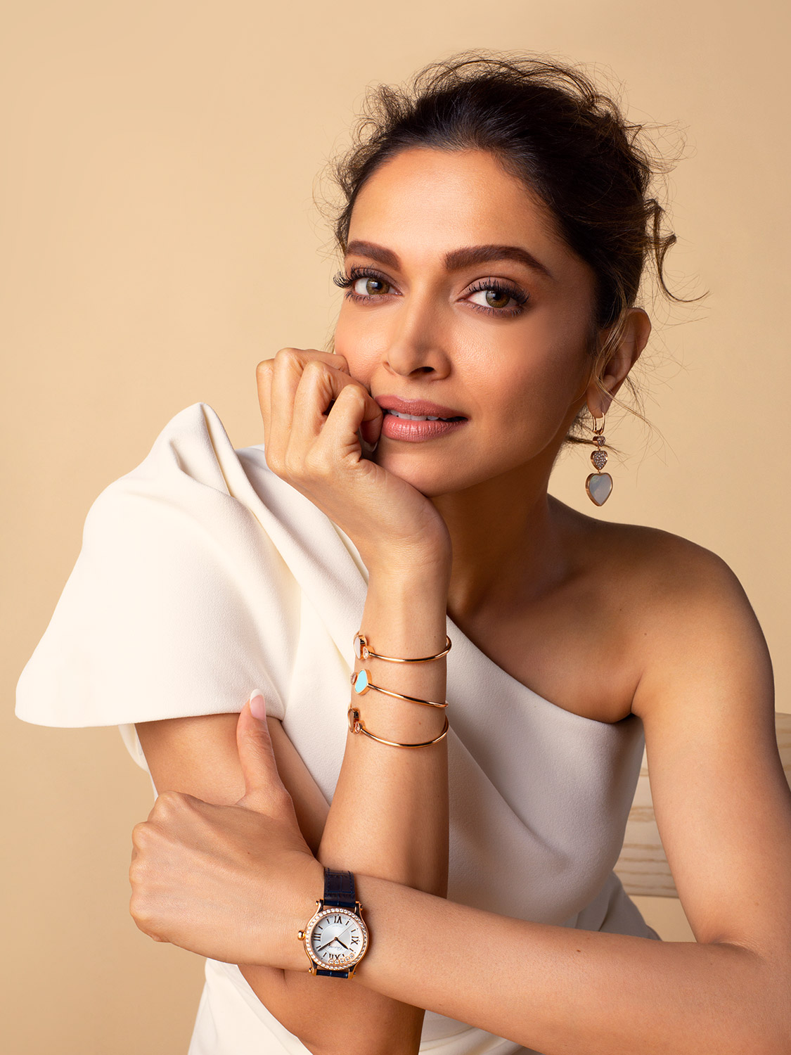 Close-up of Deepika with her hand under her chin