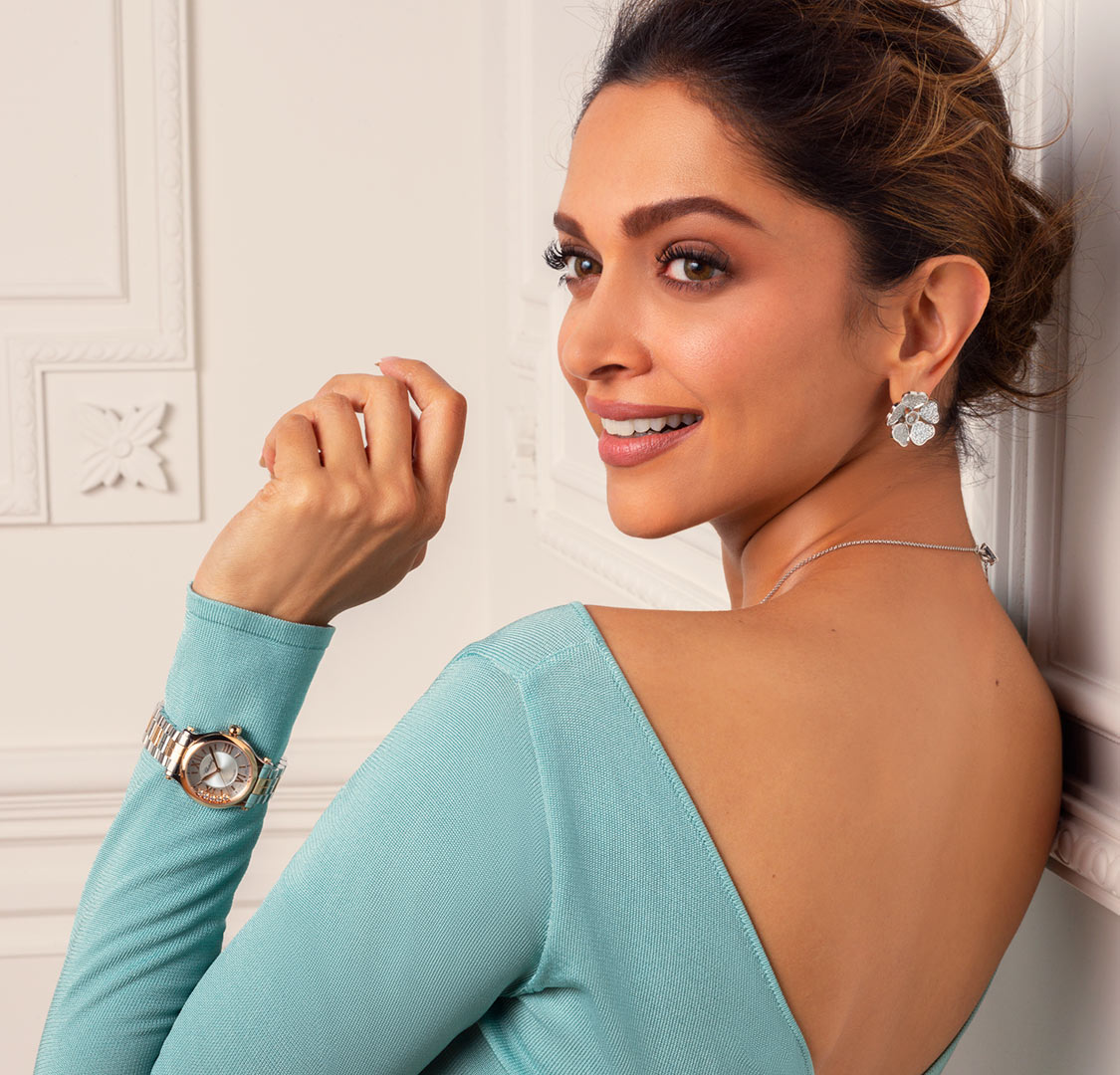 Close-up of deepika against a wall