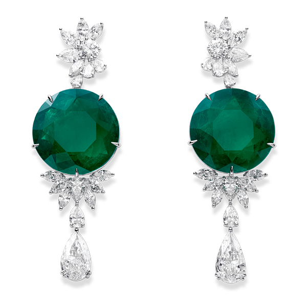 A pair of sparkling earrings set with emeralds and diamonds