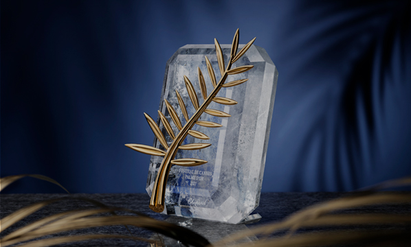 the precious and oustanding palme d'or, with a dark blue background