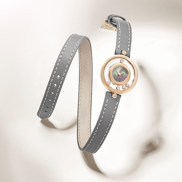 Happy Diamonds watches in gold and mother-of-pearl dial with double wrap strap