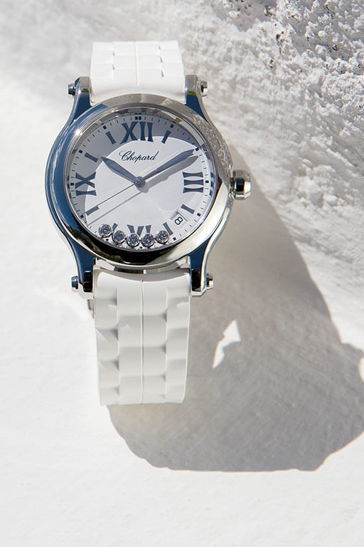 One of the stunning Happy Sport watches, from the Happy Diamonds Collection, adorned with white interchangeable straps.