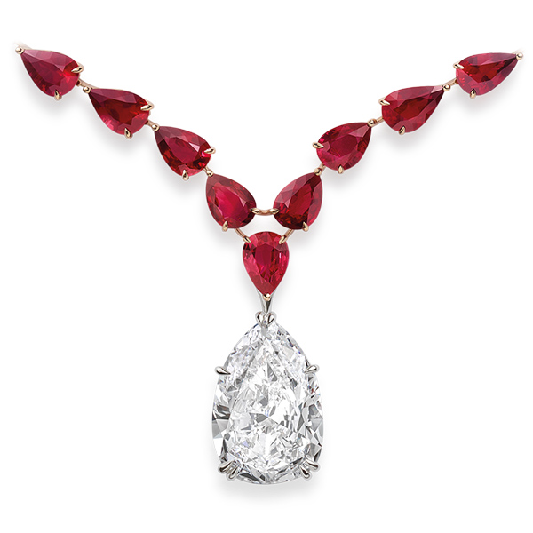 A resplendent necklace set with a pear-shaped diamond highlighted by rubies.