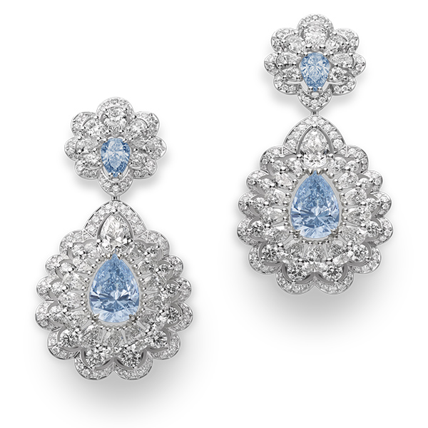 A sublime pair of 'Precious Lace' blue & white diamond earrings and an extraordinary oval-shaped blue diamond ring.