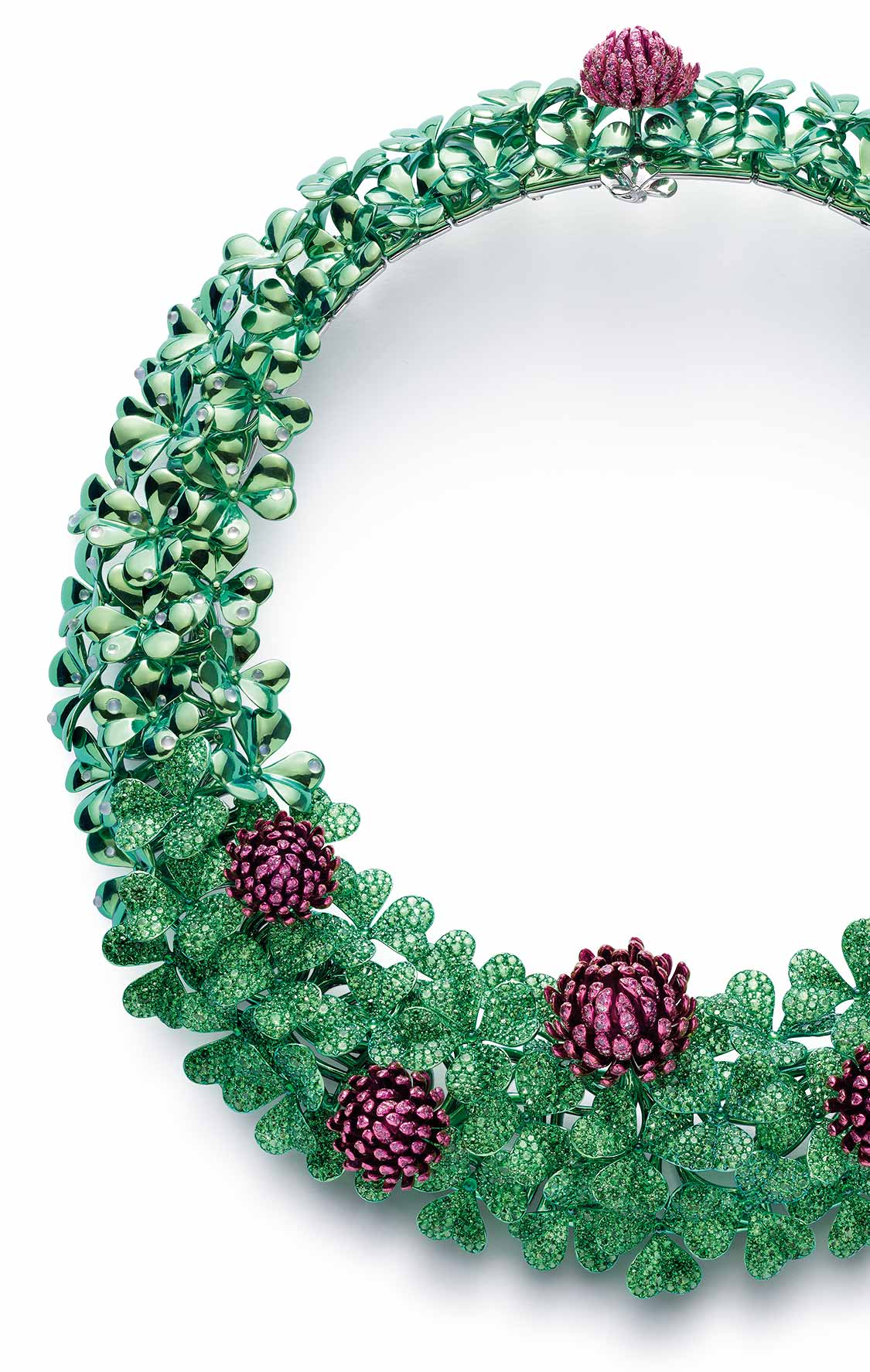 A beautiful clover-shaped necklace, designed as a meadow of jewelled flowers in tsavorites, green tourmalines, pink sapphires and moonstones.