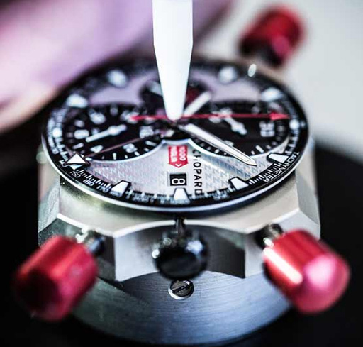 The watchmaker puts in place the chronograph's hands.