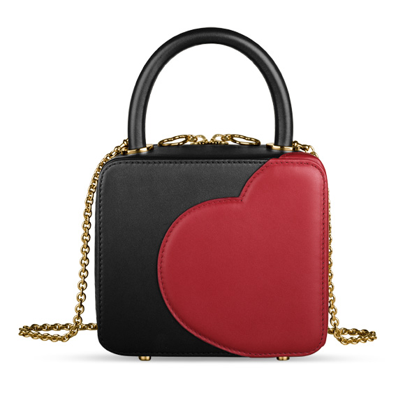 A black leather handbag designed by Chloë Sevigny and Chopard, with a big, red heart on its side.