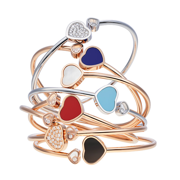 Seven Happy Hearts Bangles in different colours, and some with diamonds.