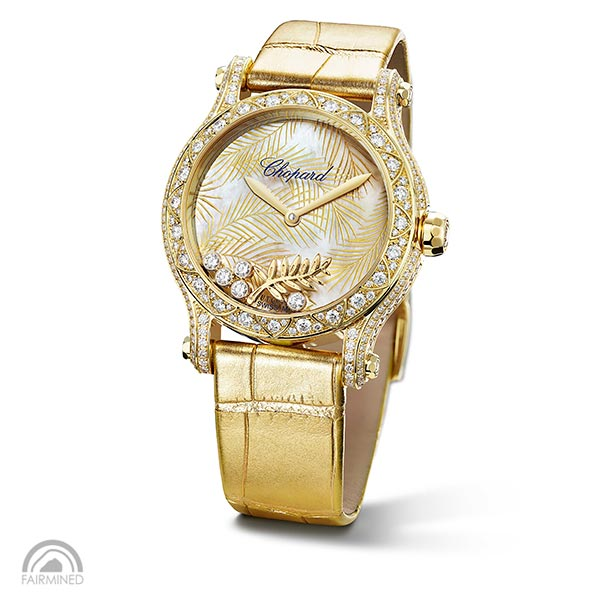 A Happy Palm watch with a golden strap,a gold case with diamonds and a nacre dial with Palme d'Or motifs and moving diamonds.
