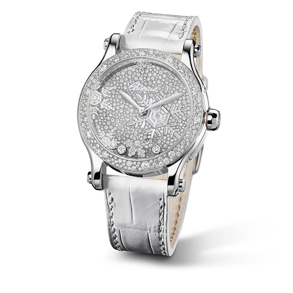 A Happy Snowflakes watch, with a white strap, a white gold case and a nacre dial recreating extremely dainty snowflakes.