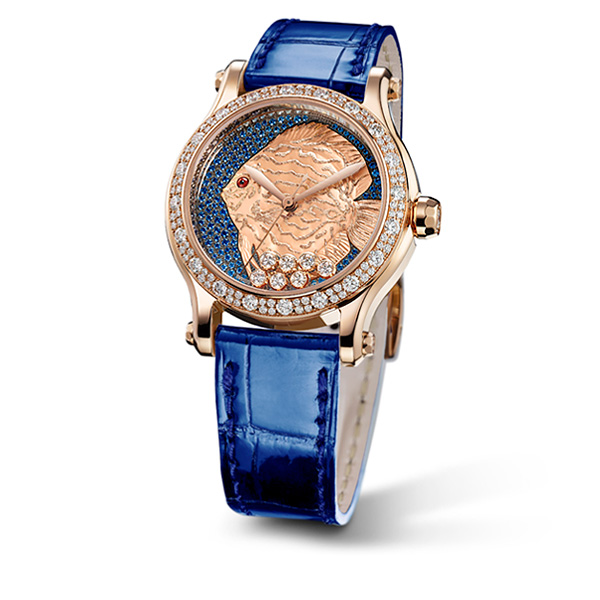 A Happy Fish watch, with a dark blue strap, a gold case set with diamonds and a dial with an engraved golden fish.