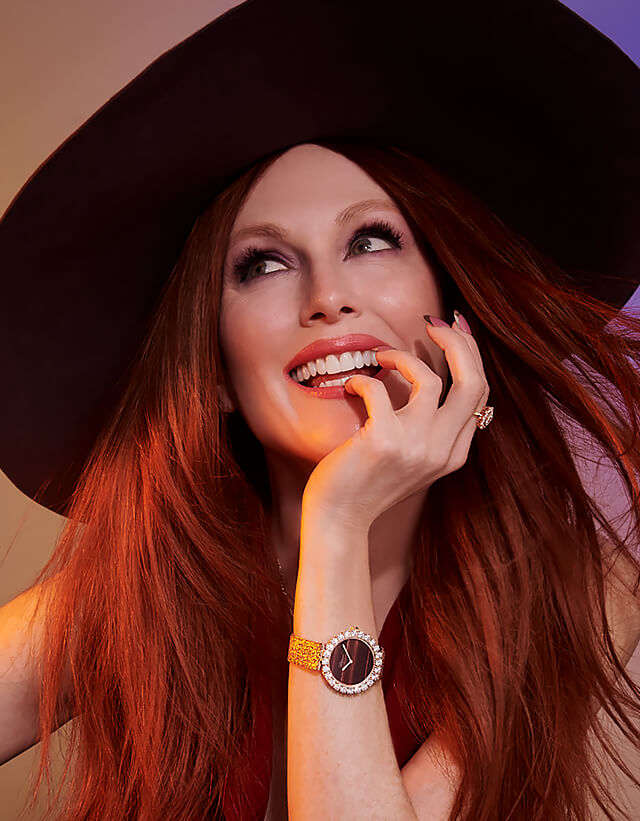Happy woman wearing a hat and a L'Heure du Diamant watch