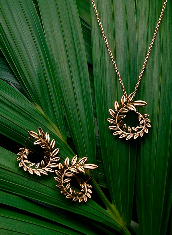 Tiny golden earrings and necklace shaped like the Palme d'Or award.