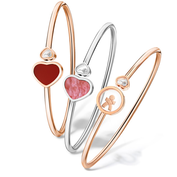 3 differents armwrists of Chopard's Happy Hearts Collection, two golden and one silvery.