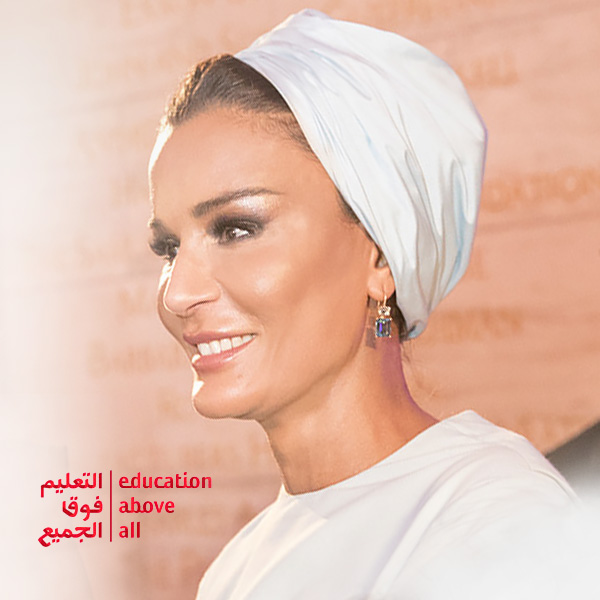 Her Highness Sheikha Moza bint Nasser, wearing a white shawl on her head.