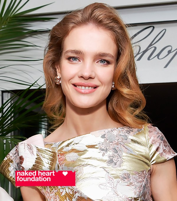 Natalia Vodianova in front of a Chopard banner.
