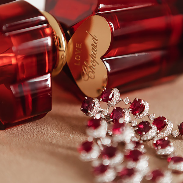 Love Chopard Fragrance bottle surrounded with Chopard High Jewellery