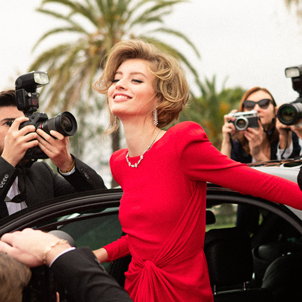 Woman leaving a car on the Red Carpet