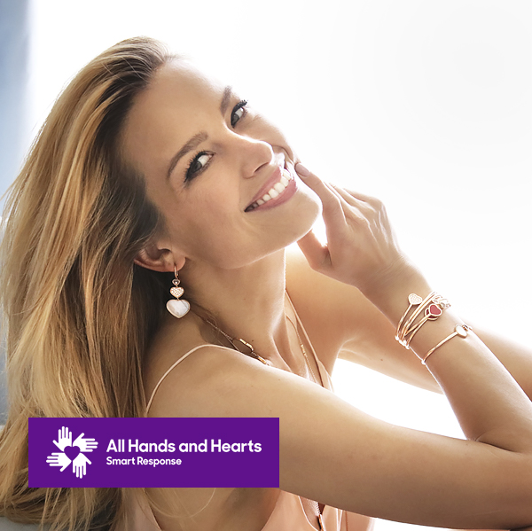 petra nemcova smiling and posing with chopard's jewellery