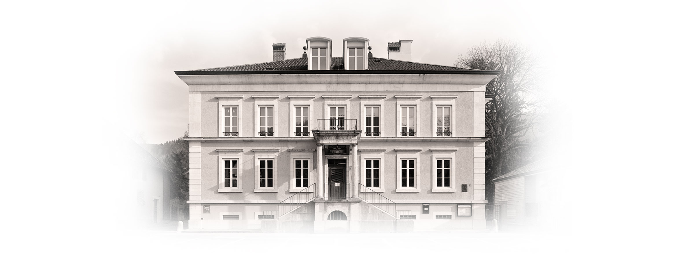Black and white photo of the Fleurier Quality Foundation Building on two floors in Fleurier