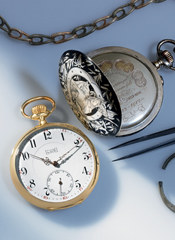 Close up image to 2 vintage Chopard Pocket watches