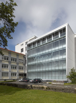 View of front facade of Chopard manufacture building in Fleurier Switzerland