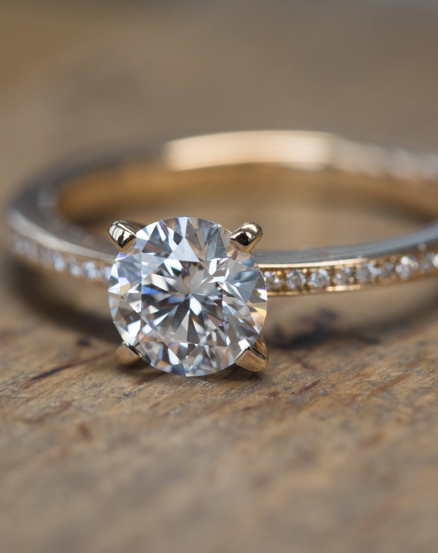 Close-up image of diamond solitaire ring with micro paved band