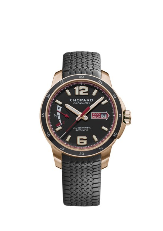 front of 18k rose gold watch with matte black dial and chronometer on black rubber strap