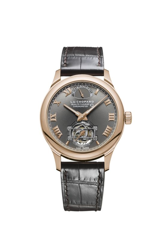 Watch with rose gold body, black designer dial and black leather strap.