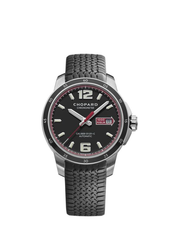 stainless steel watch with red details on black matte dial on black rubber strap
