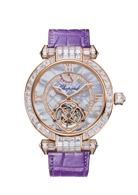watch with diamond-set mother-of-pearl dial sparkles on a purple leather strap