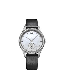 Watch with white gold body, silver dial,diamond bezel and black leather strap.