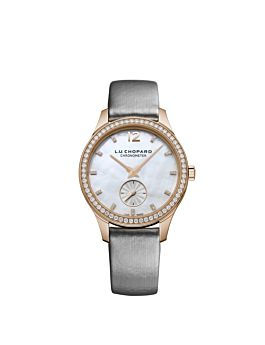 Watch with rose gold body, silver dial,diamond bezel and black leather strap.