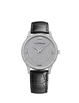 front of 18k white gold watch with diamond-set dial and bezel on black leather strap