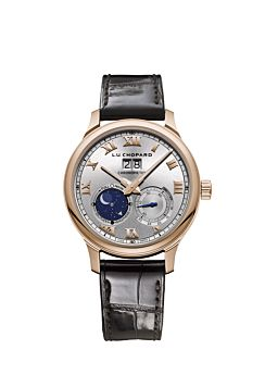 Watch with rose gold body, silver dial and black leather strap.