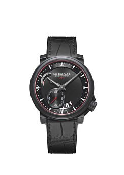 Watch with black body, black dial and black leather strap.