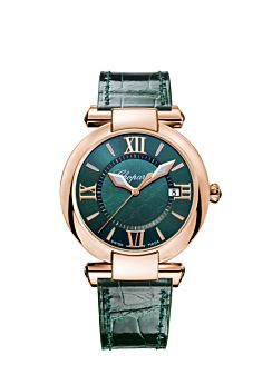 watch with rose gold case, rich green dial and leather strap.
