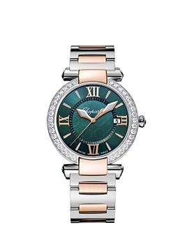 watch with rose gold and stainless steel body,  rich green dial and diamond set bezel.