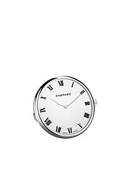 table clock  with white dial and stainless steel body.