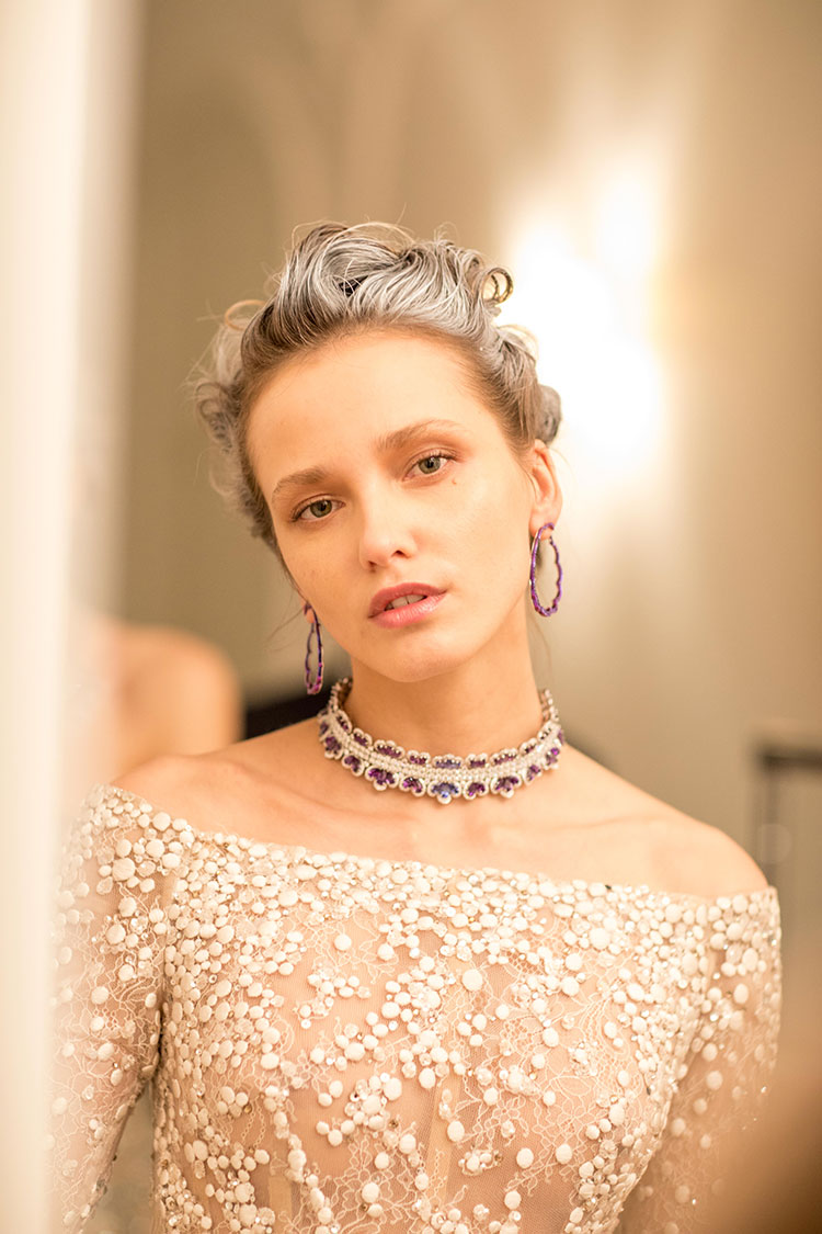 Image of model wearing precious lace collection hoop earrings and choker style necklace