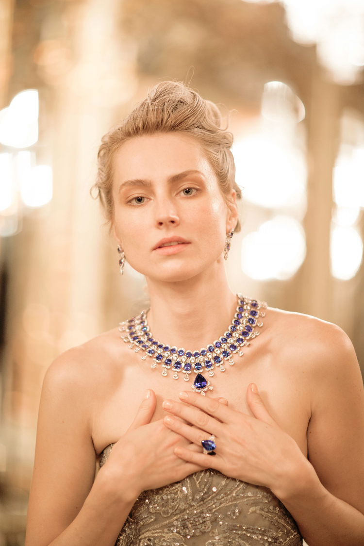 Image of Model wearing Diamond and sapphire necklace and ring from Precious Chopard Collection