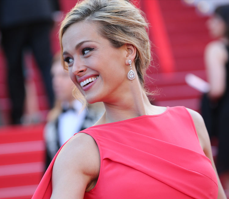 Image of Model petra nemcova wearing Chopard Diamond earrings while walking the Cannes film festival red carpet
