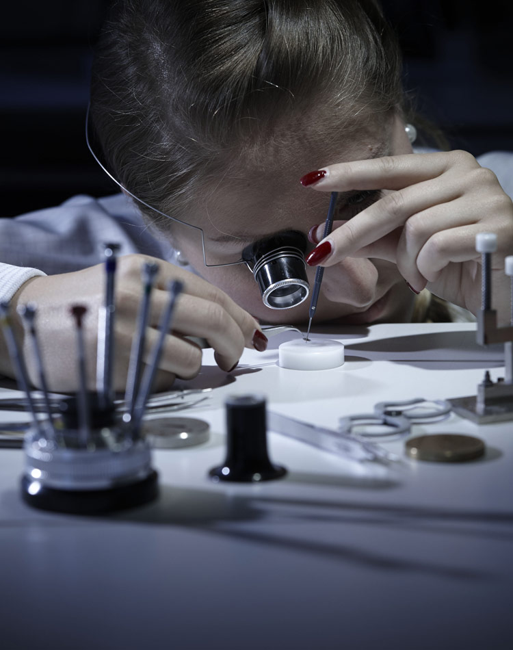 Image of Chopard watch maker working on a movement