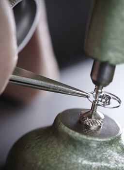 Watchmaker working on a watch movement
